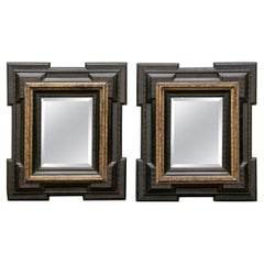 Pair of Antique Hand Carved, Ebonized and Gilt Frames Set with Mirrors