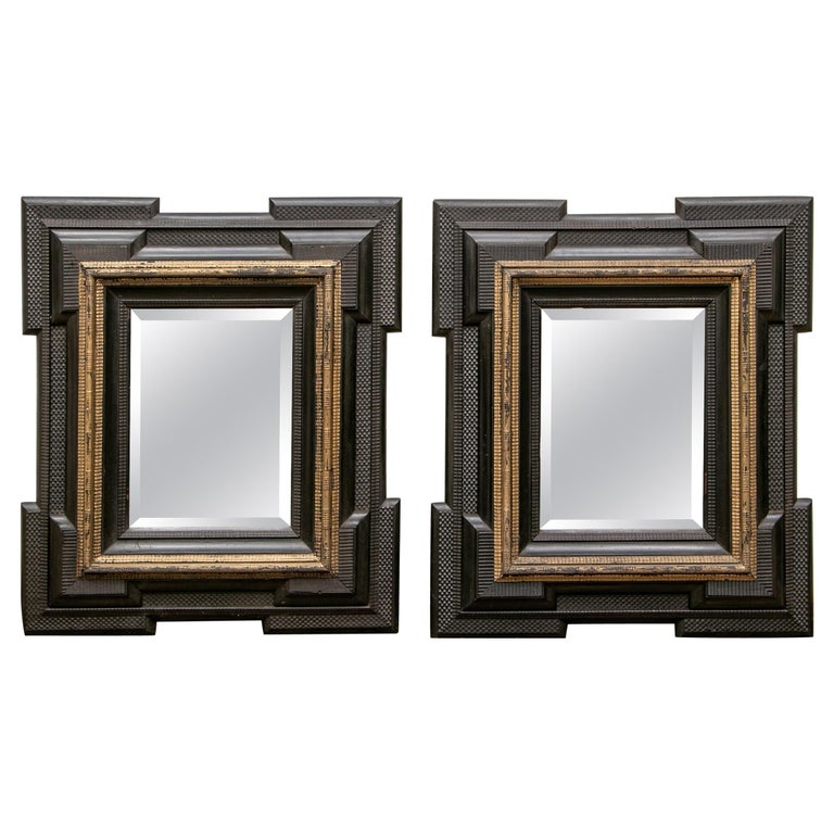 Pair of Antique Hand Carved, Ebonized and Gilt Frames Set with Mirrors For Sale