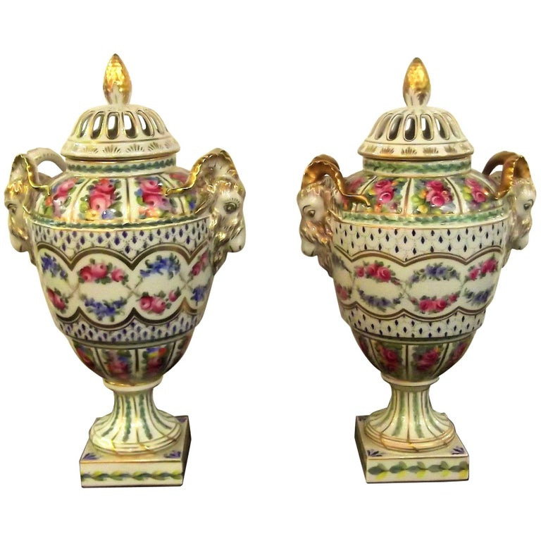 Pair of Antique Hand Painted Porcelain Dresden Urns with Lids For Sale