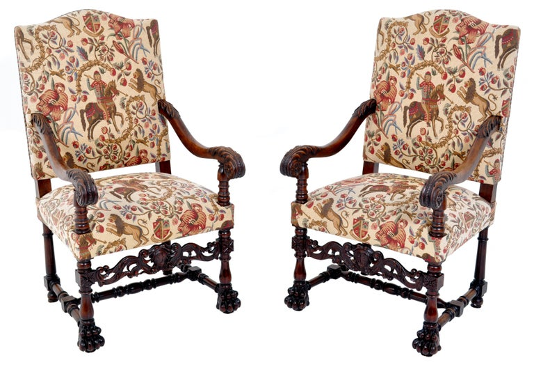 Pair of antique baroque carved mahogany throne chairs, circa 1870. These very substantial chairs having scrolled arm-rests with acanthus leaves and terminating to rosettes. Each chair raised on turned legs with an ornately carved central stretcher