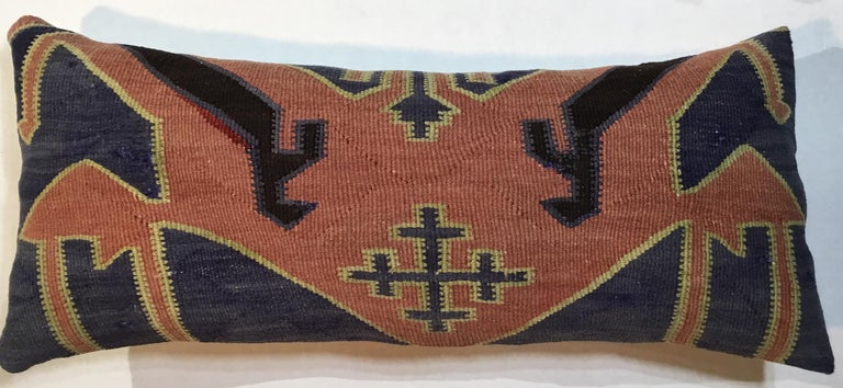 """Exceptional pair of pillows made of handwoven flat-weave antique Kazak rug fragment, beautiful geometric motifs with salmon, yellow, black, muted -gray, and orange colors. Fine linen and cotton backing. Sizes: Measures: 10"""" x 19"""" x 4"""" 10"""" x 23"""" x"""