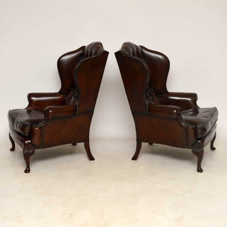 English Pair of Antique Leather Wing Back Armchairs For Sale