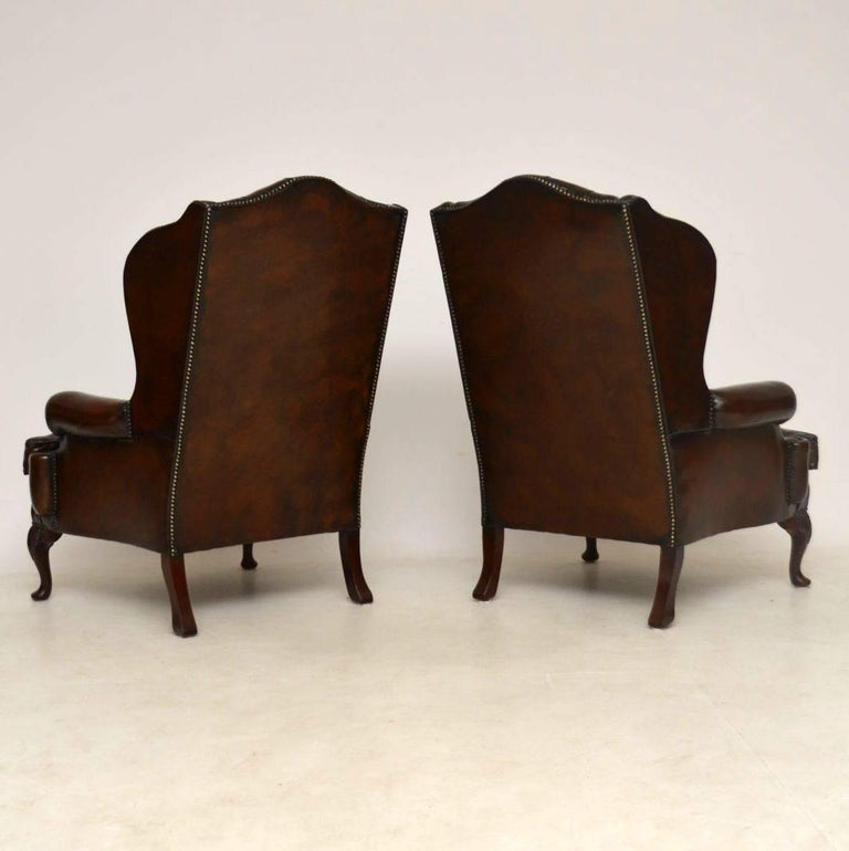 Mid-20th Century Pair of Antique Leather Wing Back Armchairs For Sale