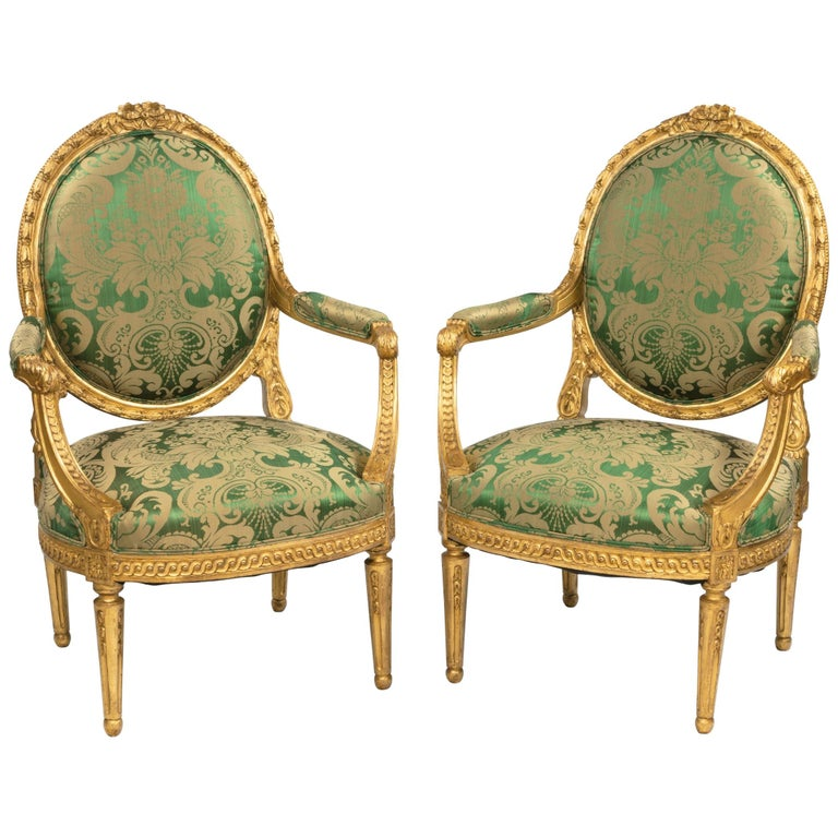 Pair of Antique Louis XVI Style Carved Armchairs with Green Upholstery For Sale