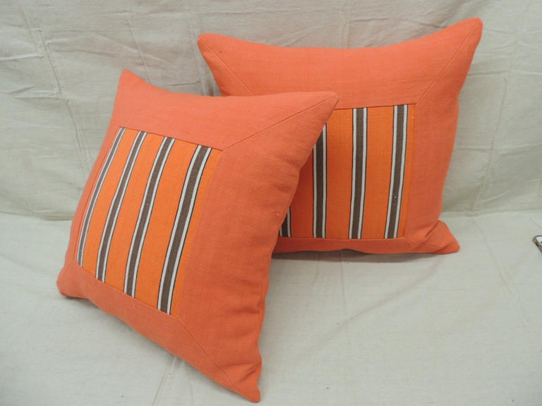 Pair of antique orange stripes square decorative pillows.