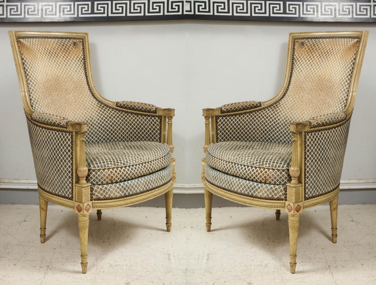 Pair of antique painted Directoire-style bergeres.