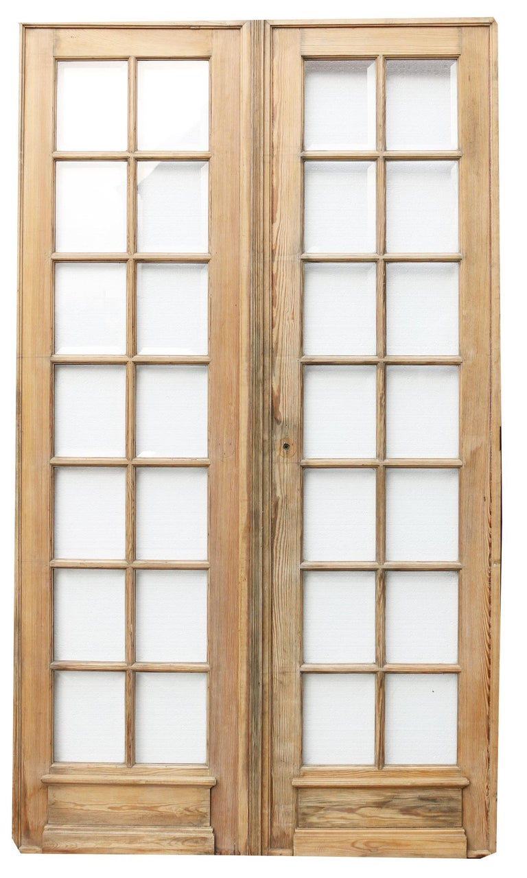 About:  These beautiful pine French doors feature beveled single glazing.  Condition report:  There are no hinges or handles present. In good condition for their age, with minor scratches. Stripped finish.   Style:  French  Date of
