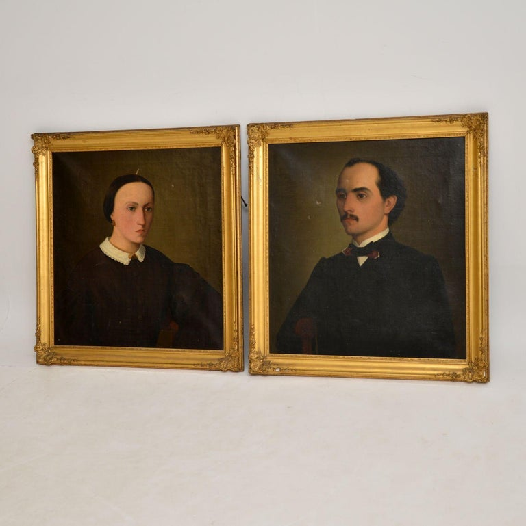 A wonderful pair of antique oil paintings in original gilt frames. These are most likely English and date from the mid-19th century.  They depict a man and a woman, as they were evidently made at the same time and framed together, so they are most