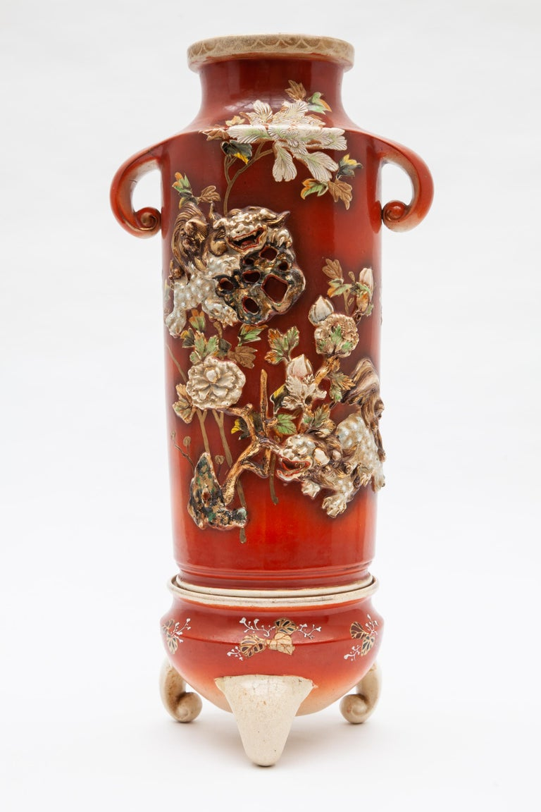Antique Japonese vases with three-footed stands, marked.