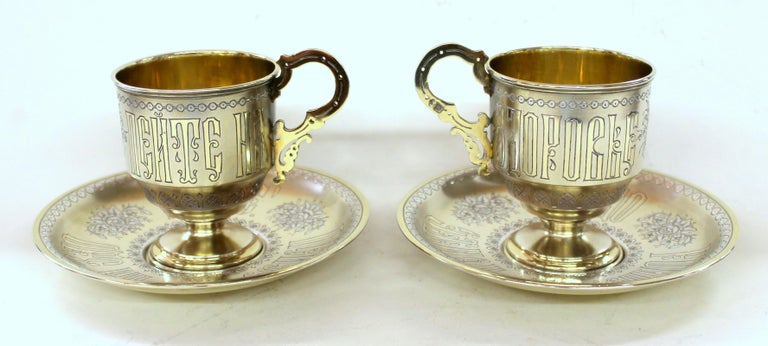 Pair of extraordinary quality antique Russian .875 fine silver vermeil hand engraved rare toasting cups and saucers.  Gilt