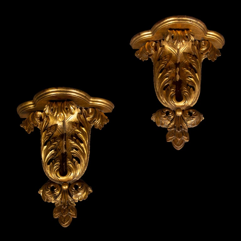 A decorative pair of carved and gilded wood wall brackets in the William Kent Baroque taste, shaped as roman acanthus foliage, early to mid-20th century.  Why we like them Boldly sculpted in the manner, evoking the decoration in ancient Rome,