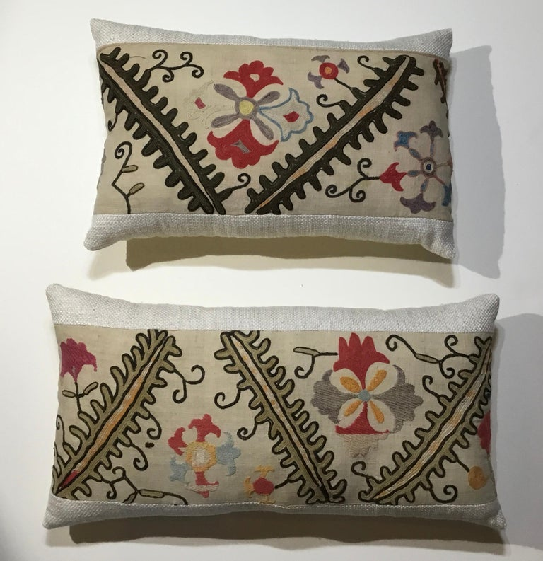 """Beautiful pair of pillows made of hand embroidery on handmade cotton background, colorful motifs of vine and flowers motifs, fine cotton trimming and fine silk backing, Frash new inserts. Size: 19"""" x 12"""" x 4"""" 22"""" x 11"""".5 x 4""""."""