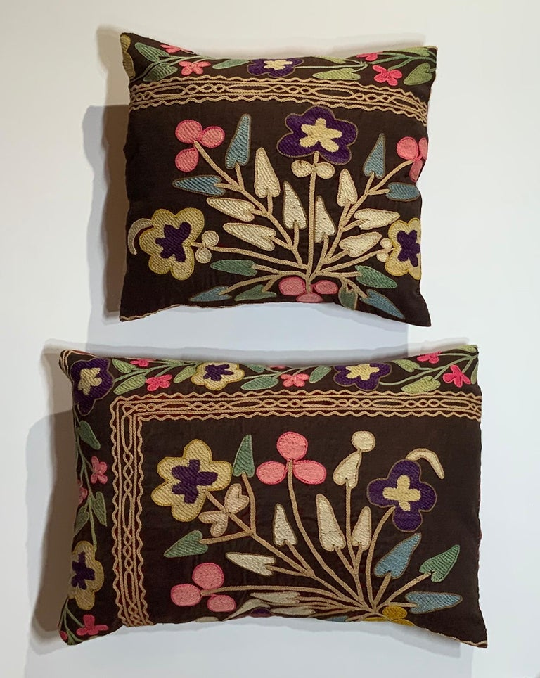 """Exceptional pair of pillows made of antique hand embroidery Suzani fragment, beautiful colors, vines and flowers motifs Embroidery on antique oxidized wine color velvet background, quality cotton backing, fresh new insert. Sizes: 17"""" x 11"""" 5"""". 12"""""""