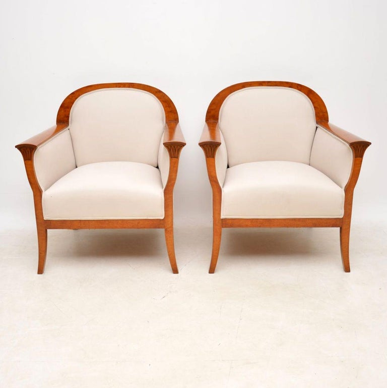 Very stylish pair of Swedish antique Satin Birch armchairs that have just been fully re-upholstered in a cream fabric. They are in excellent condition, having just been French polished & I would date them to around the 1910 period, or perhaps a