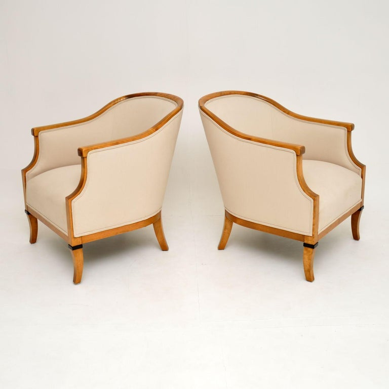 A stunning pair of antique Swedish armchairs made from Satin Birch. These date from circa 1910-1920 period, they are extremely well made.  We've just had the frames French polished, and they have been newly upholstered in our lovely cream fabric.