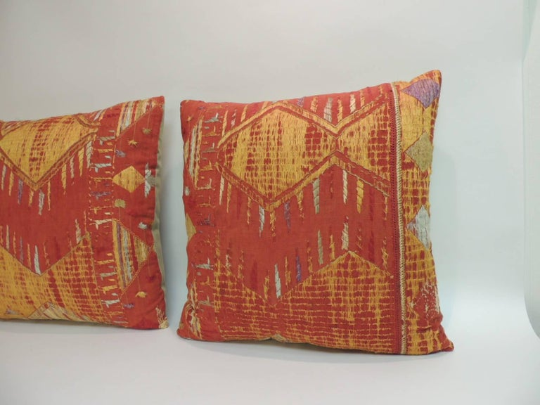 19th century embroidered linen pillows. Silk and cotton floss threads creating a tribal geometric design. Decorative pillow handcrafted and designed in the USA. Closure by stitch (no zipper closure) with a custom-made pillow insert. Size: 20 x 20 x