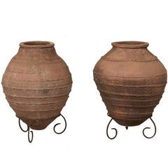Pair of Antique Turkish Olive Jars Made of Terracotta on Scrolled Metal Stands