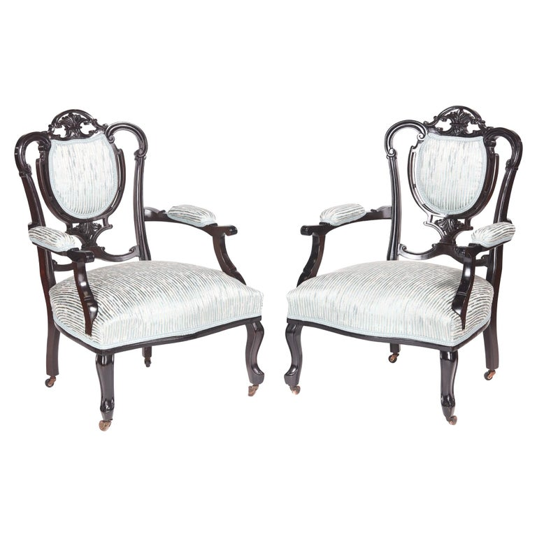 Pair of Antique Victorian Carved Black Lacquered Library Chairs For Sale