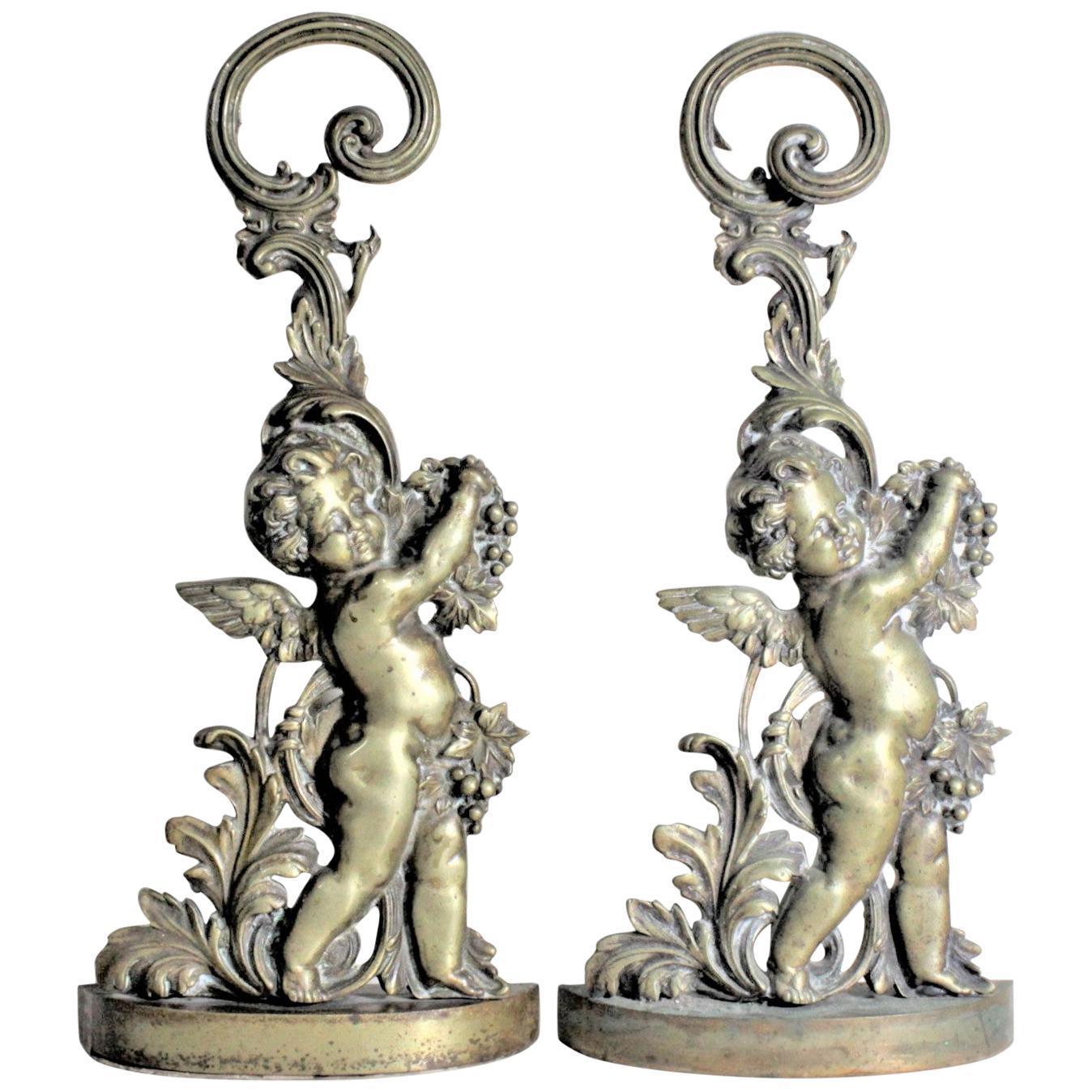 Pair of Antique Victorian Cast Brass Figural Cherub Door Stops or Sculptures