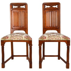 Pair of Antique Victorian Gothic Revival Chairs in Carved Walnut, 19th Century