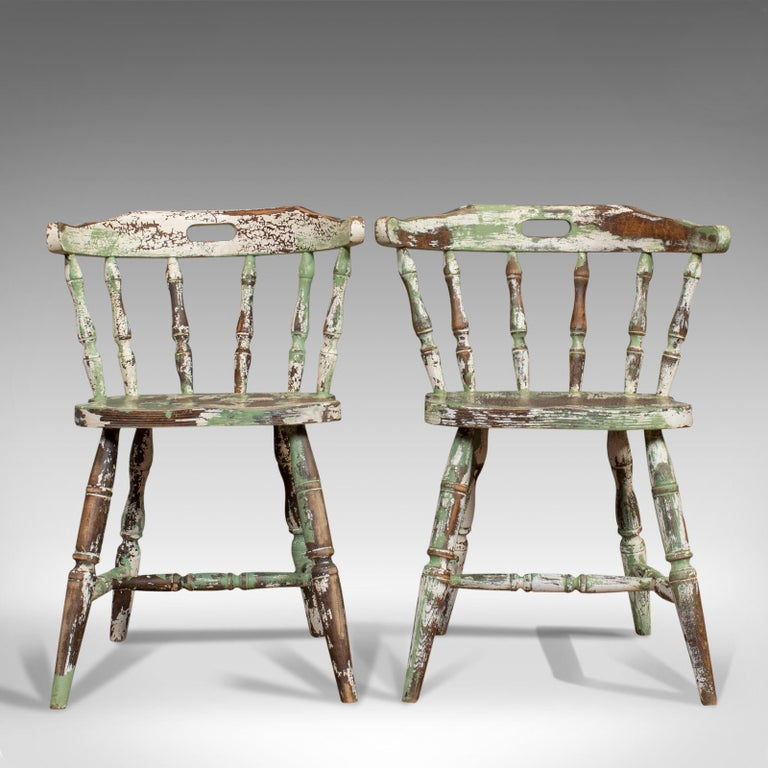 This is a pair of antique Windsor chairs. A French, beech bow-back chair, dating to the late 19th century, circa 1900.  French country farmhouse taste Displays a desirable aged patina Crafted from solid, dark French beech Painted finish