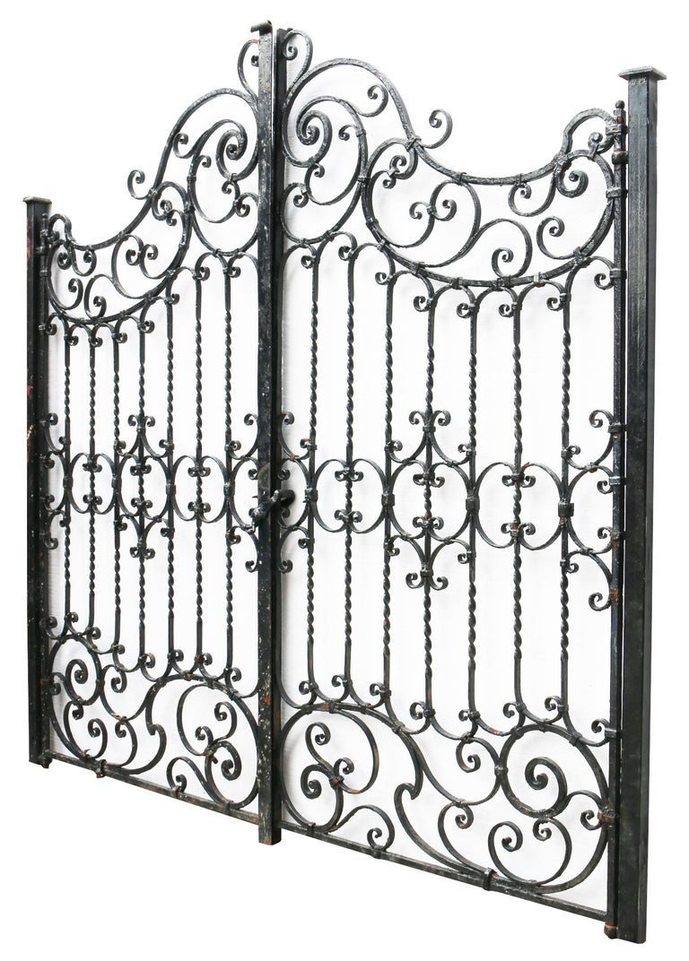 About  A beautiful pair of English blacksmith made wrought iron gates and posts in ready to hang condition. Reclaimed form a private house in Oxfordshire.   Condition report:  The gate is in excellent structural condition with no losses or