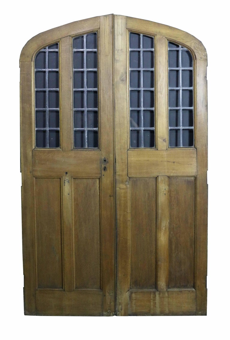 Gothic Pair of Arched Oak Double Doors with Leaded Glass Panel, circa 1900 For Sale