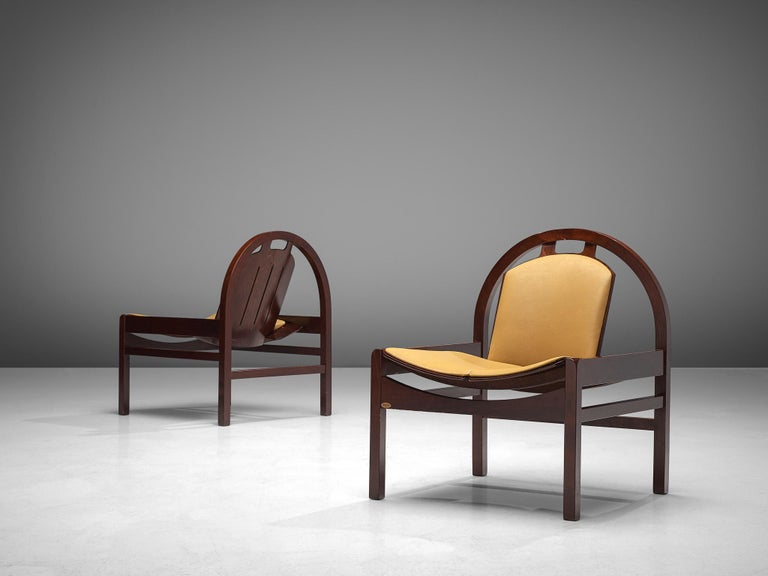 Baumann, set of two 'Argos' easy chairs, beech and leather, France, 1970s