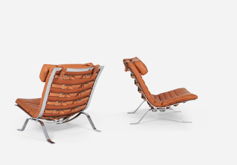 Pair of Ari chairs with one ottoman by Arne Norell. Made in Sweden circa 1970s for Norell Mobel AB.