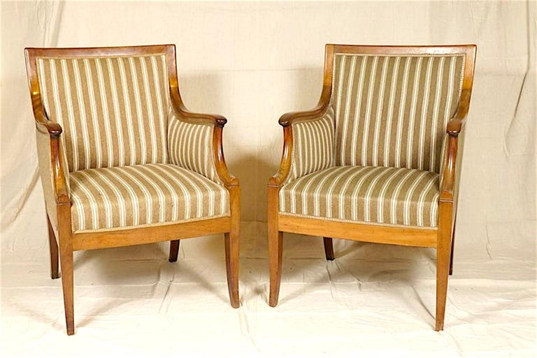 Stylish pair of armchairs by Danish designer Frits Henningsen, neoclassical style in mahogany.  Frits Henningsen (1889–1965) was a Danish furniture designer and cabinet maker who achieved high standards of quality with exclusively handmade