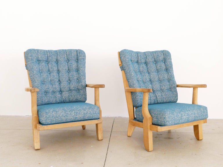 Two armchairs in excellent condition. The frame is solid, clean and in perfect condition. The new cushions have a teal colored cotton fabric reminiscent of the era of production. The spine work of the back are the signature of the artists. These