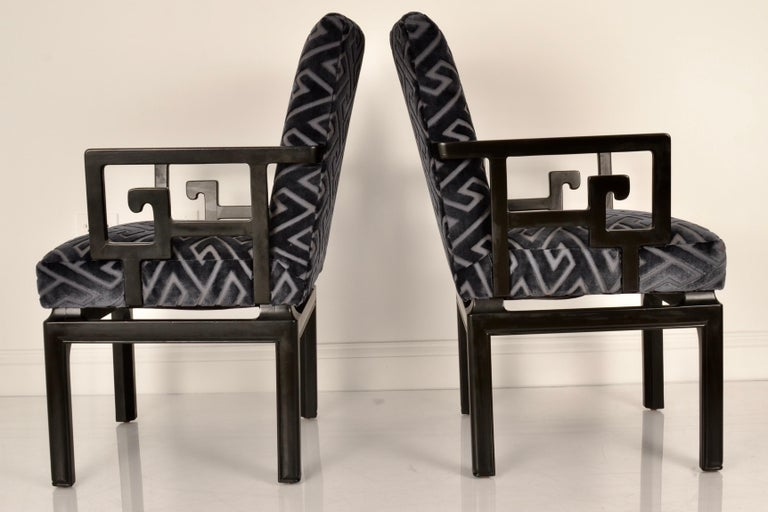 A modern Classic from the Far East collection designed by Michael Taylor for Baker Furniture, launched in 1949. These chairs have been fully restored in black satin lacquer and all new upholstery featuring a Greek key patterned cut velvet in a dark