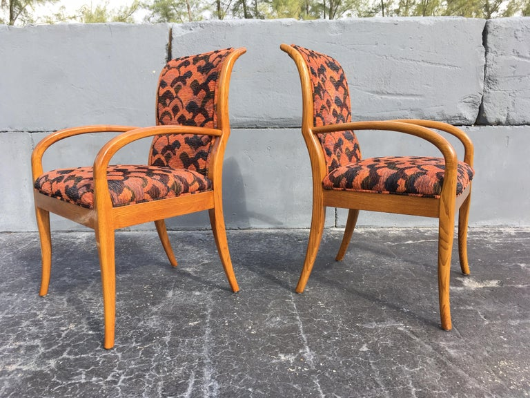 Great pair of armchairs in the style of Robsjohn-Gibbings or Parzinger. Chairs need to be reupholstered, we can help.