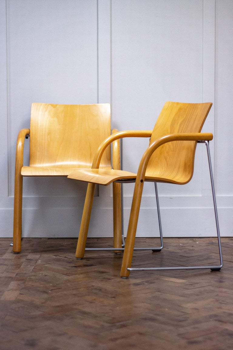 Pair of armchairs by Ulrich Bohme/ Wulf Schneider for Thonet.  These award winning chairs (S320) range were designed in 1984 for Thonet.  The chair has solid metal and beech legs, with a beech ply seat. These chairs are stackable, sturdy and