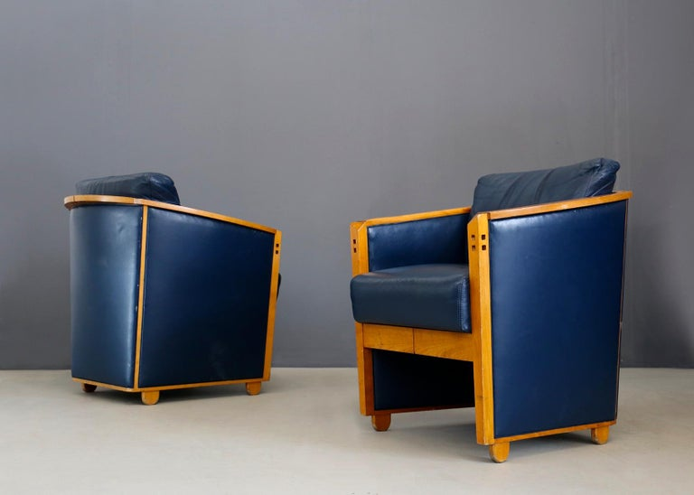 Beautiful pair of armchairs by Umberto Asnago for Giorgetti, 1990. The pair of armchairs are made of blue leather and are very well held. However, they are not damaged, but there are some imperfections due to time and wear. The armchairs have a