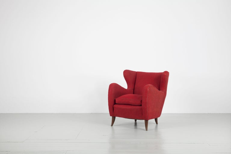 Pair of armchairs - Design by Melchiorre Bega, Italy, 1950s. The chairs have a compact curved form and feature the original red upholstery fabric. The armchairs are freshly cleaned and in original condition.  Feel free to contact us for more