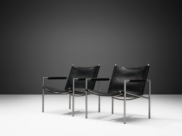Martin Visser, pair of armchairs, leather and metal, The Netherlands, 1965.  These modern, Minimalist easy chairs are executed with a tubular brushed steel frame in combination with soft, patinated black leather upholstery. The armrests are