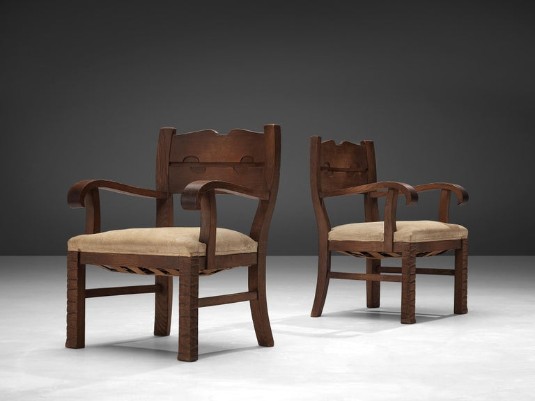 Ernesto Valabrega, pair of armchairs, oak, fabric upholstery, Italy, ca. 1935  Pair of armchairs in oak and beige, floral patterned upholstery by Italian designer Ernesto Valabrega. A wide upholstered seat provides great comfort. Also the armrests