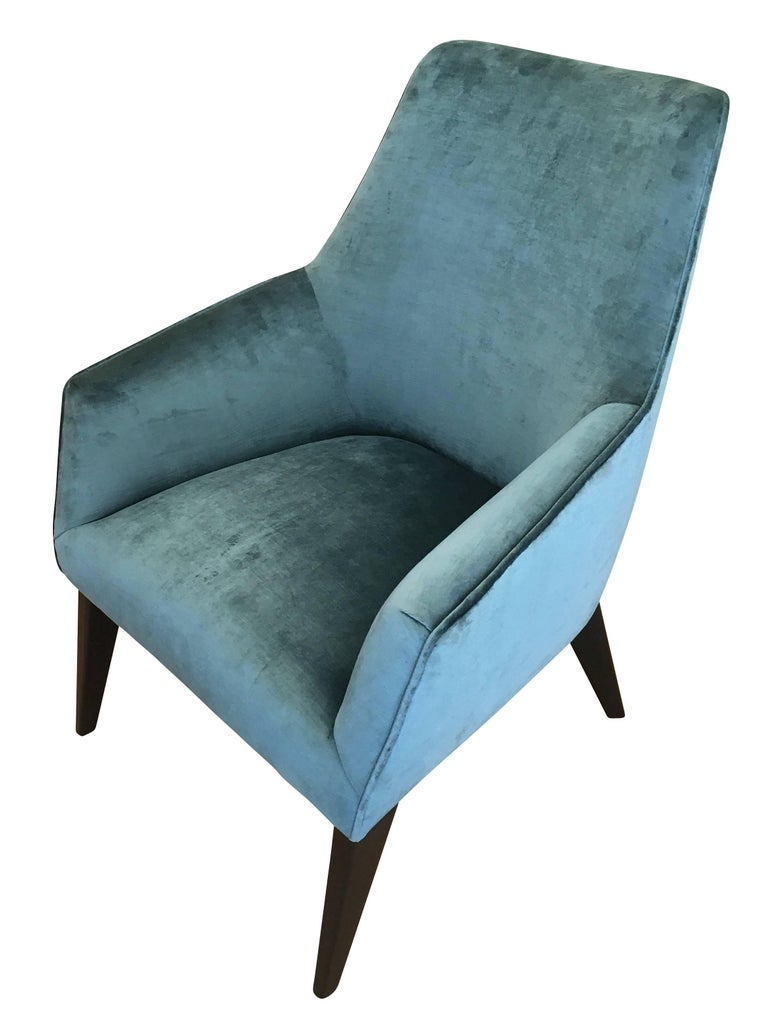 Pair of midcentury lounge chairs in the manner of Gio Ponti with ebonized legs. One has been upholstered in a teal velvet for display purposes and the other is still in original condition. Price per pair but can be sold separately if needed.
