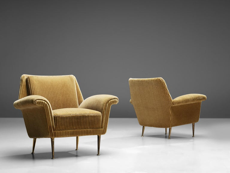 Pair of lounge chairs, mustard colored velvet, metal, Italy, 1950s.  Set of two armchairs with beautiful designed frame and mustard colored velvet upholstery. The seating is slightly tilted to give the chair an inviting appearance. The armrests are