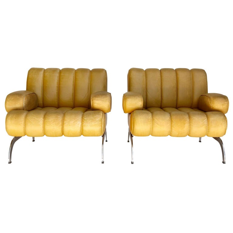 A pair of armchairs named 'Independence' designed by Karl Wittmann and manufactured by Wittmann Möbelwerkstätten, Austria, in midcentury, circa 1970. These are very rare pieces, especially in yellow. The leather has great patina. A pair of