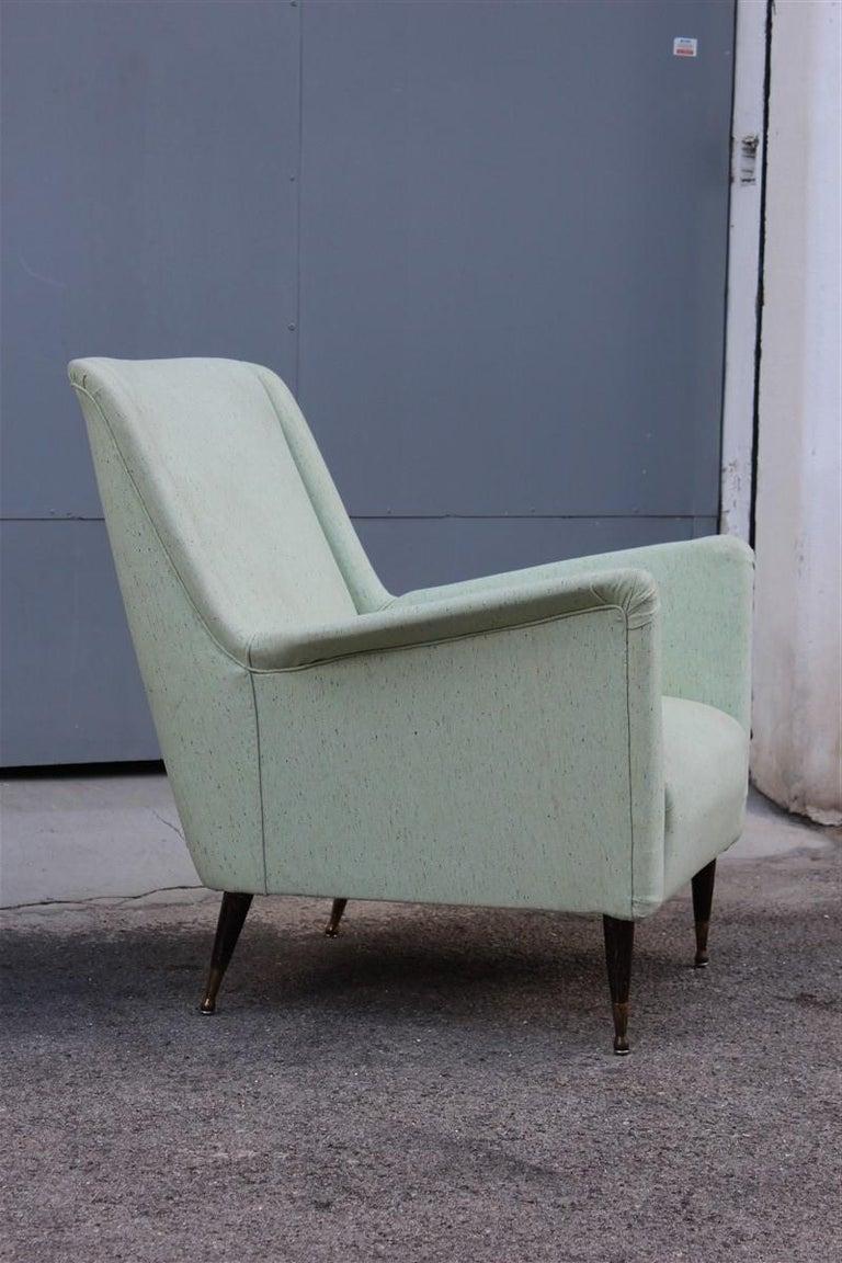 Pair of armchairs midcentury Italian design wood feet brass green Gio Ponti style.