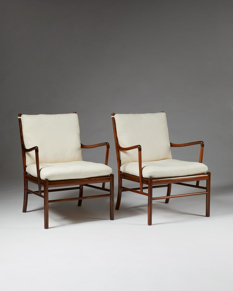 Denmark, 1949. Solid rosewood with woven cane. Cushions upholstered in light Savak wool.  Marked by P. Jeppesen.  Measures: H 84 cm, 2' 9