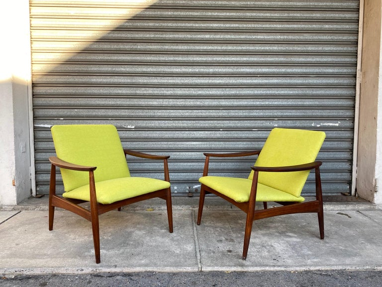 Pair of Portuguese armchairs, in the style of Altamira editions, 1960s.