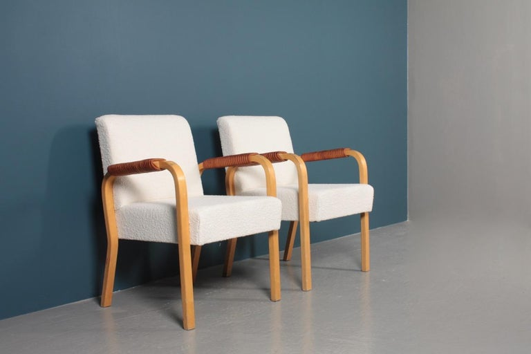 Mid-Century Modern Pair of Armchairs with Bouclé and Patinated Leather by Alvar Aalto, 1950s For Sale