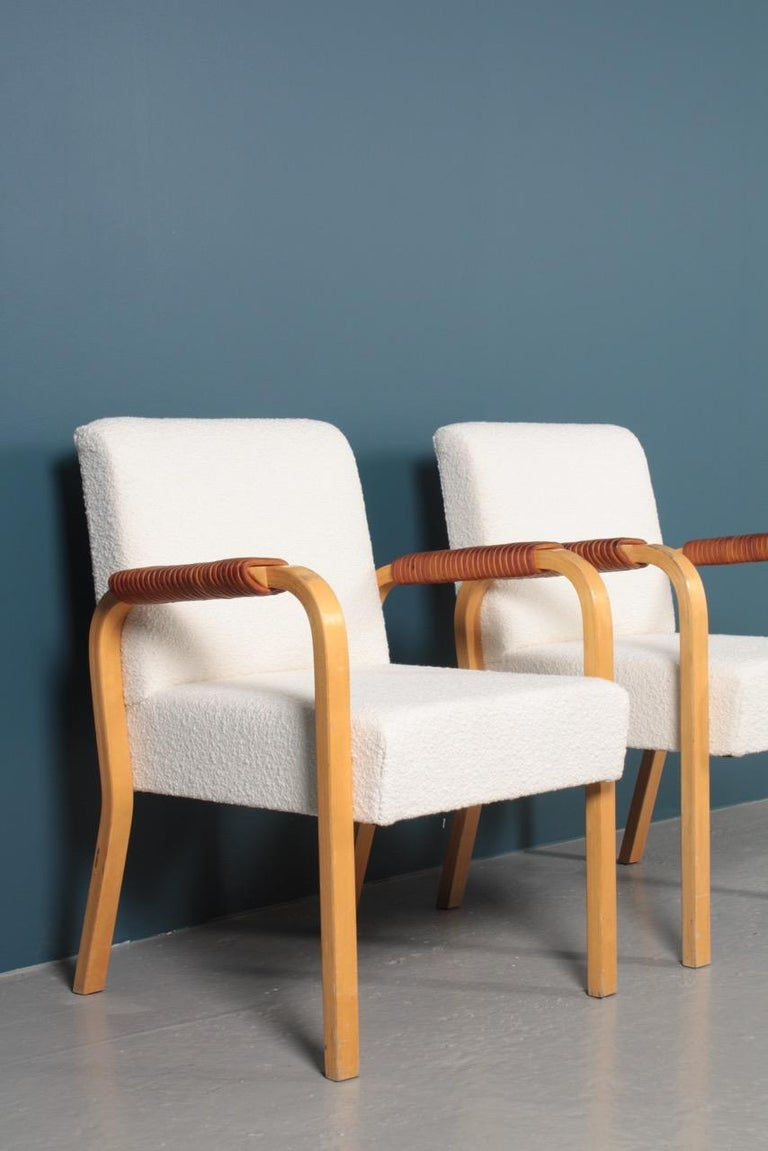 Finnish Pair of Armchairs with Bouclé and Patinated Leather by Alvar Aalto, 1950s For Sale