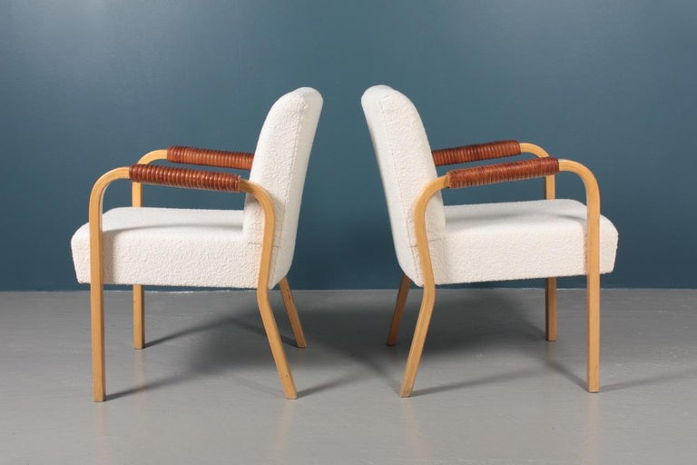 Pair of Armchairs with Bouclé and Patinated Leather by Alvar Aalto, 1950s For Sale 1