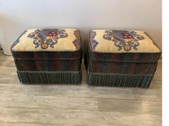 Pair Of Armorial Upholstered Ottomans With Bouillon Fringe