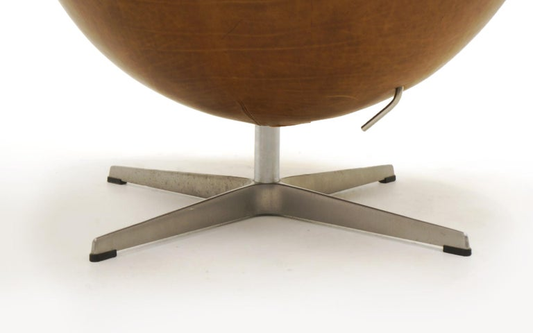 Pair Arne Jacobsen Egg Chairs with Ottomans, Cognac Leather. Price is for all. 3