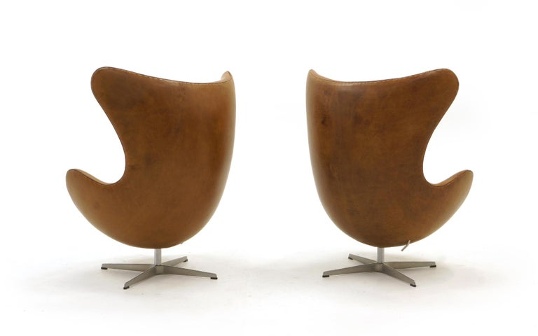 Danish Pair Arne Jacobsen Egg Chairs with Ottomans, Cognac Leather. Price is for all.